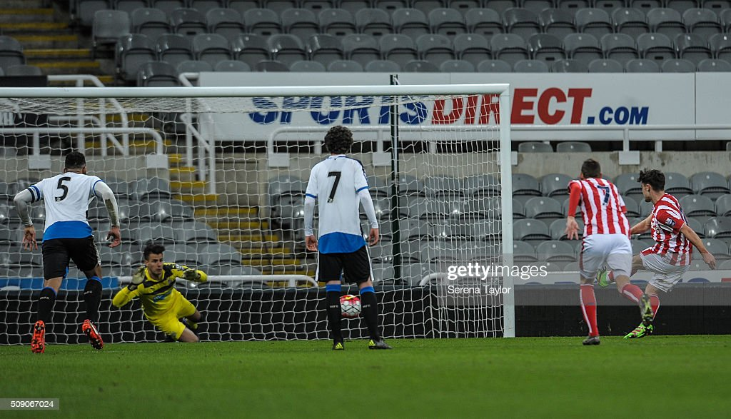 Dominic Telford of Stoke City (R) strikes the ball to take a penalty against Newcastle goalkeeper Karl Darlow during the Barclays Premier League U21 match between Newcastle United and Stoke City at St.James' Park on February 8, 2016, in Newcastle upon Tyne, England.