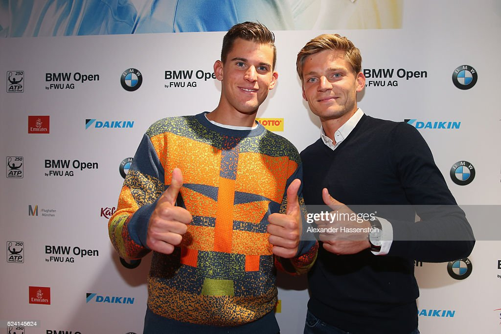 Dominic Thieam of Austria arrives with <a gi-track='captionPersonalityLinkClicked' href=/galleries/search?phrase=David+Goffin&family=editorial&specificpeople=2291768 ng-click='$event.stopPropagation()'>David Goffin</a> (R) of Belgium for the Players Night of the BMW Open at Iphitos tennis club on April 25, 2016 in Munich, Germany.