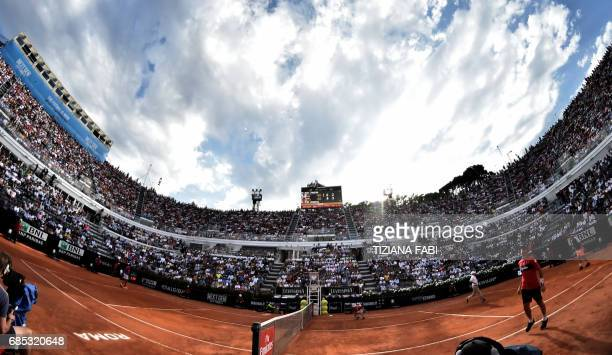 Dominic Thiem of Austria and Rafael Nadal of Spain play during their quarterfinal at the ATP Tennis Open tournament on May 19 2017 at the Foro...