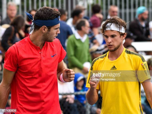 Dominic Thiem of Austria and teammate Karen Khachanov of Russia congradulate one another in their doubles match against Nicholas Monroe and Jack Sock...