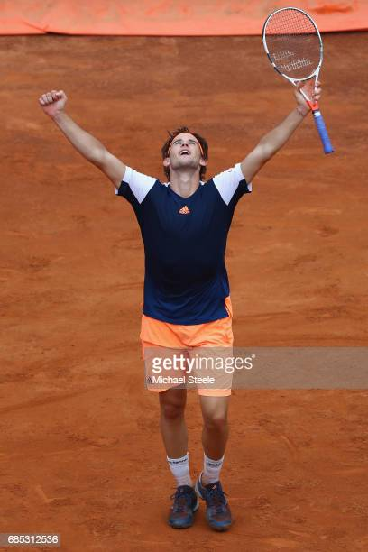 Dominic Thiem of Austria celebrates match point in his straight sets quarterfinal match against Rafael Nadal of Spain on Day Six of the...