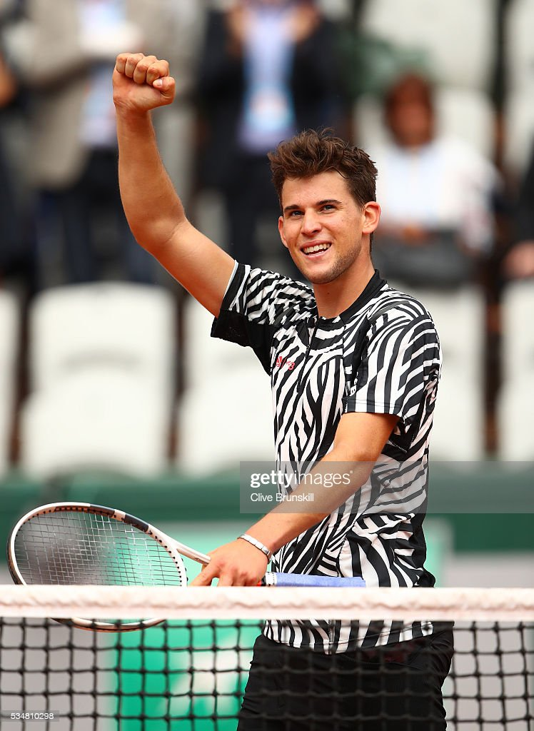 <a gi-track='captionPersonalityLinkClicked' href=/galleries/search?phrase=Dominic+Thiem&family=editorial&specificpeople=7026383 ng-click='$event.stopPropagation()'>Dominic Thiem</a> of Austria celebrates victory during the Men's Singles third round match against Alexander Zverev of Germany on day seven of the 2016 French Open at Roland Garros on May 28, 2016 in Paris, France.