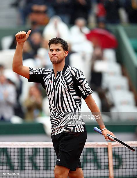Dominic Thiem of Austria celebrates victory during the Men's Singles quarter final match against David Goffin of Belgium on day twelve of the 2016...