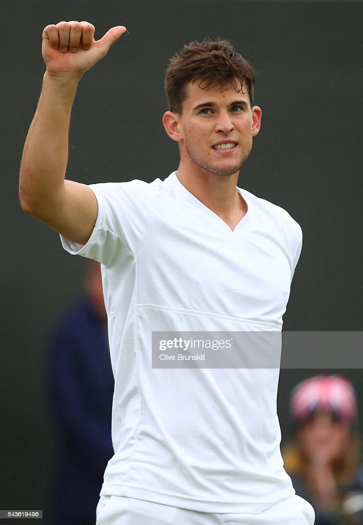 <a gi-track='captionPersonalityLinkClicked' href=/galleries/search?phrase=Dominic+Thiem&family=editorial&specificpeople=7026383 ng-click='$event.stopPropagation()'>Dominic Thiem</a> of Austria celebrates victory during the Men's Singles first round match against Florian Mayer of Germany on day three of the Wimbledon Lawn Tennis Championships at the All England Lawn Tennis and Croquet Club on June 29, 2016 in London, England.