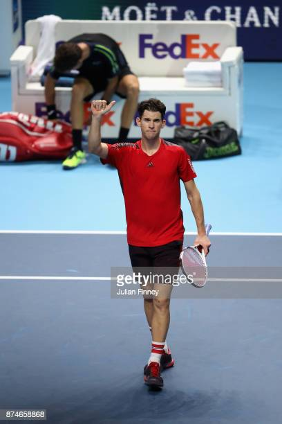 Dominic Thiem of Austria celebrates victory during the singles match against Pablo Carreno Busta of Spain on day four of the 2017 Nitto ATP World...