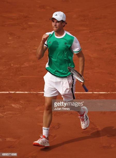 Dominic Thiem of Austria celebrates victory following the mens singles first round match against Bernard Tomic of Australia on day one of the 2017...