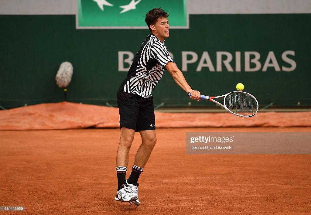 <a gi-track='captionPersonalityLinkClicked' href=/galleries/search?phrase=Dominic+Thiem&family=editorial&specificpeople=7026383 ng-click='$event.stopPropagation()'>Dominic Thiem</a> of Austria hits a backhand during the Men's Singles second round match against Guillermo Garcia-Lopez of Spain on day five of the 2016 French Open at Roland Garros on May 26, 2016 in Paris, France.