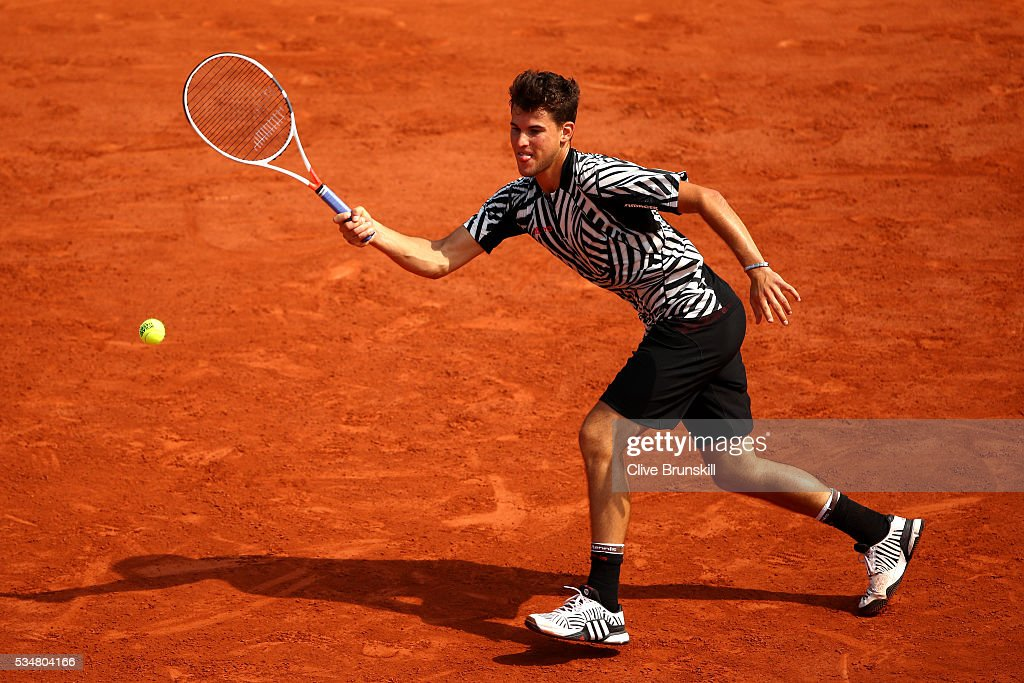 <a gi-track='captionPersonalityLinkClicked' href=/galleries/search?phrase=Dominic+Thiem&family=editorial&specificpeople=7026383 ng-click='$event.stopPropagation()'>Dominic Thiem</a> of Austria hits a forehand during the Men's Singles third round match against Alexander Zverev of Germany on day seven of the 2016 French Open at Roland Garros on May 28, 2016 in Paris, France.