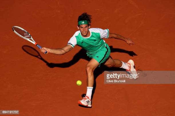 Dominic Thiem of Austria hits a forehand during the men's singles semi final match against Rafael Nadal of Spain on day thirteen of the 2017 French...