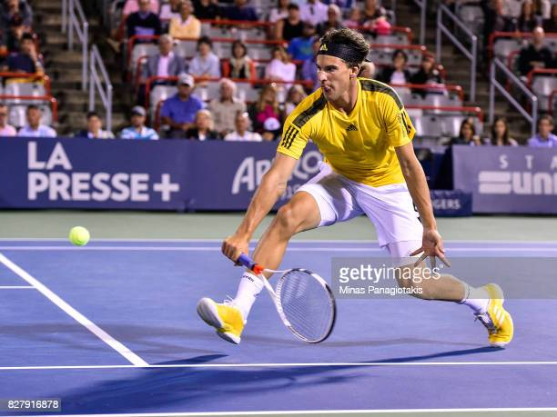 Dominic Thiem of Austria hits a return shot against Diego Schwartzman of Argentina during day five of the Rogers Cup presented by National Bank at...