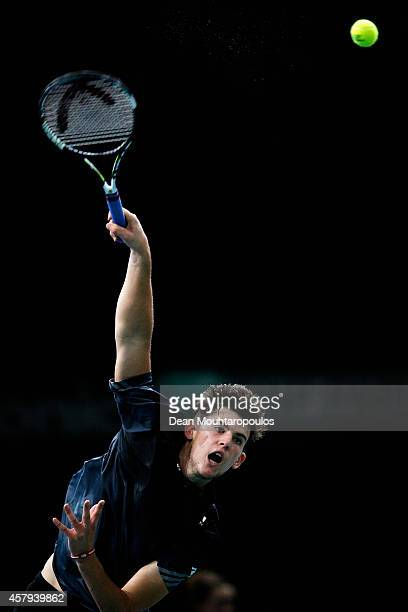 Dominic Thiem of Austria in action against Alexandr Dolgopolov of Ukraine during day 1 of the BNP Paribas Masters held at the at Palais Omnisports de...