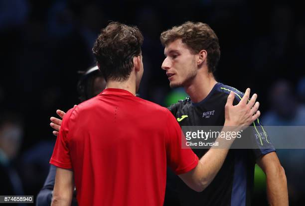 Dominic Thiem of Austria is congratulated on victory by opponant Pablo Carreno Busta of Spain in the singles match on day four of the 2017 Nitto ATP...