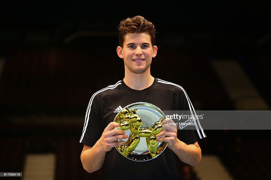 Dominic Thiem of Austria lifts the trophy after victory in his match against Andy Murray of Great Britain during Tie Break Tens at Wiener Stadthalle on October 23, 2016 in Vienna, Austria.