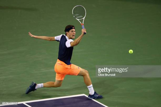 Dominic Thiem of Austria plays a backhand against Gael Monfils of France in their fourth round match during day ten of the BNP Paribas Open at Indian...