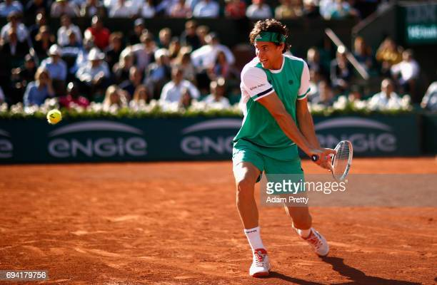 Dominic Thiem of Austria plays a backhand during mens singles semifinal match against Rafael Nadal of Spain on day thirteen of the 2017 French Open...