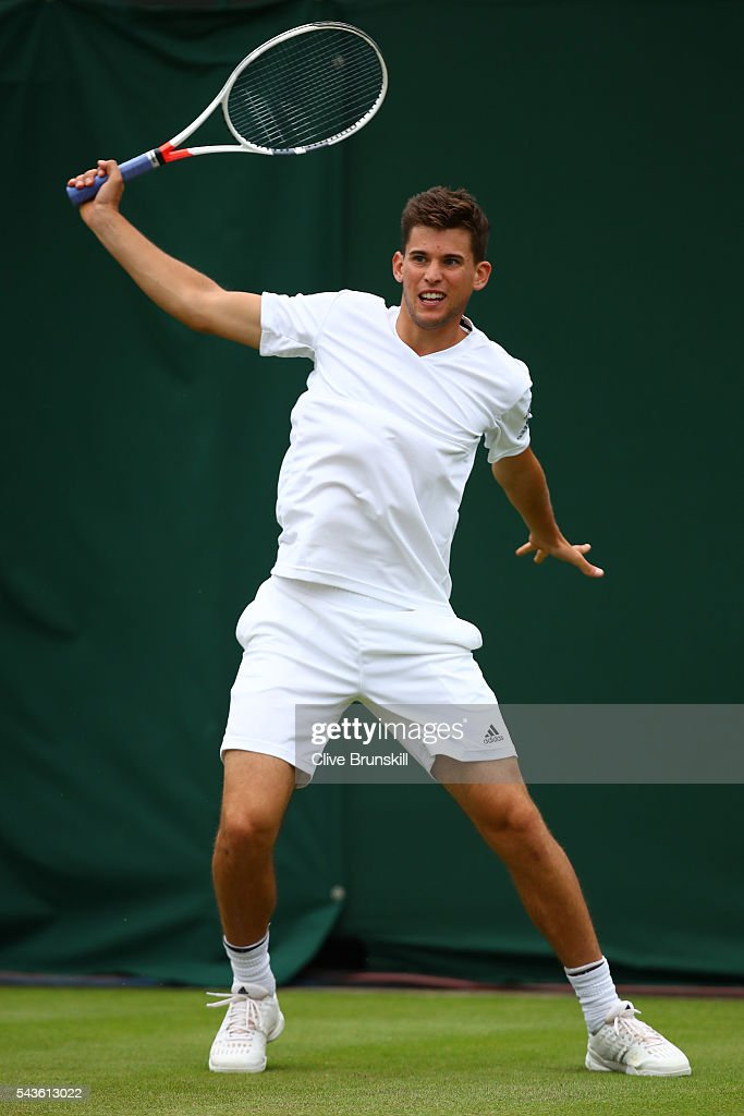 <a gi-track='captionPersonalityLinkClicked' href=/galleries/search?phrase=Dominic+Thiem&family=editorial&specificpeople=7026383 ng-click='$event.stopPropagation()'>Dominic Thiem</a> of Austria plays a backhand during the Men's Singles first round match against Florian Mayer of Germany on day three of the Wimbledon Lawn Tennis Championships at the All England Lawn Tennis and Croquet Club on June 29, 2016 in London, England.