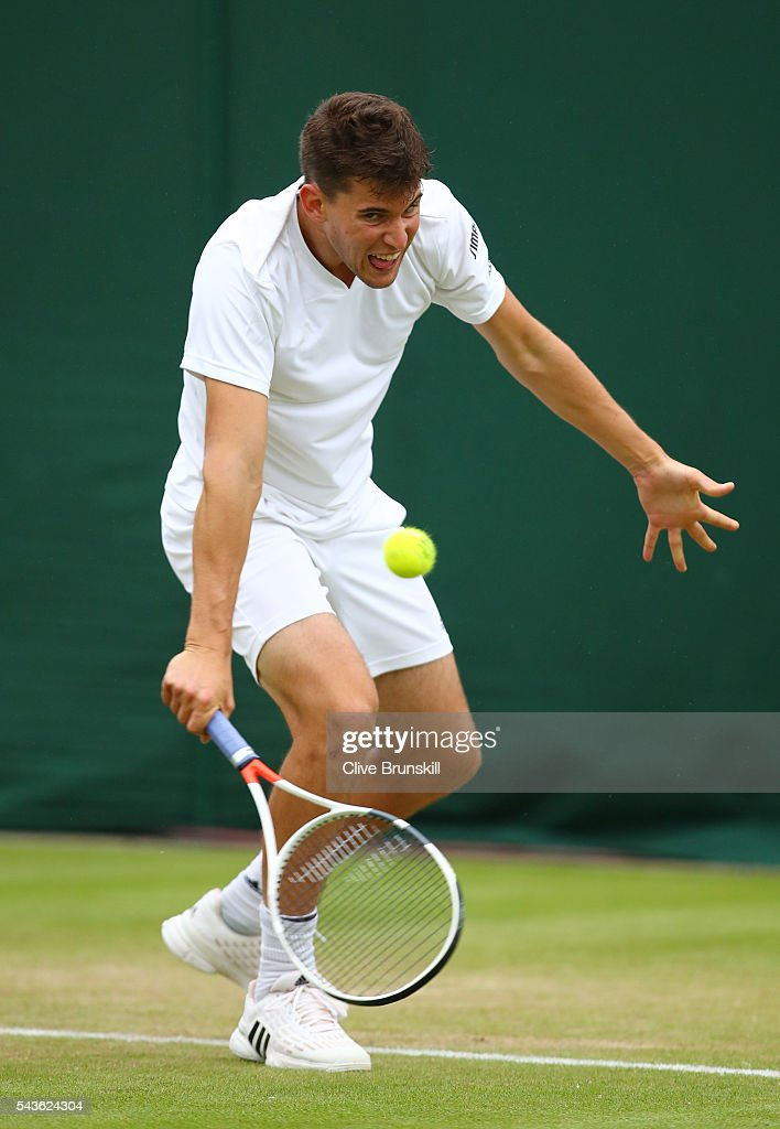 Dominic Thiem of Austria plays a backhand during the Men's Singles first round match against Florian Mayer of Germany on day three of the Wimbledon Lawn Tennis Championships at the All England Lawn Tennis and Croquet Club on June 29, 2016 in London, England.