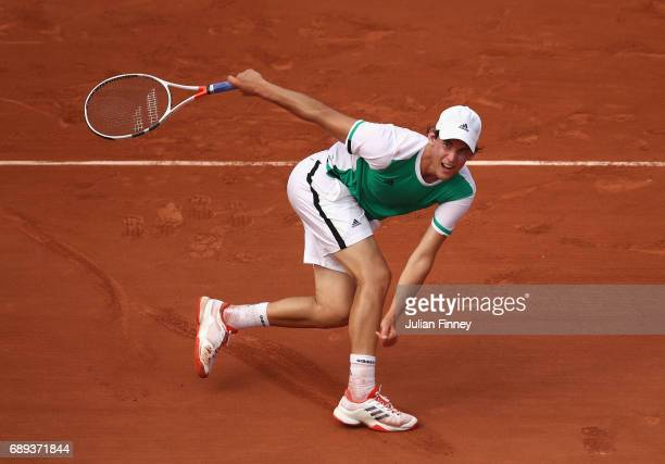Dominic Thiem of Austria plays a backhand during the mens singles first round match against Bernard Tomic of Australia on day one of the 2017 French...
