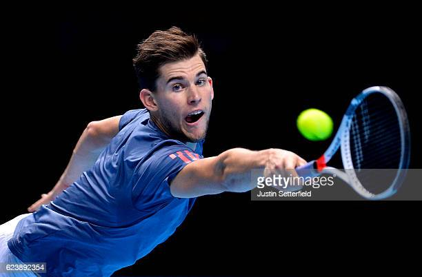 Dominic Thiem of Austria plays a backhand in his men's singles match against Milos Raonic of Canada on day five of the ATP World Tour Finals at O2...