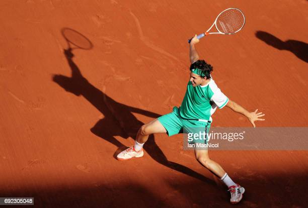 Dominic Thiem of Austria plays a backhand shot during his match with Horacio Zeballos of Argentina on Day Eight at Roland Garros on June 4 2017 in...