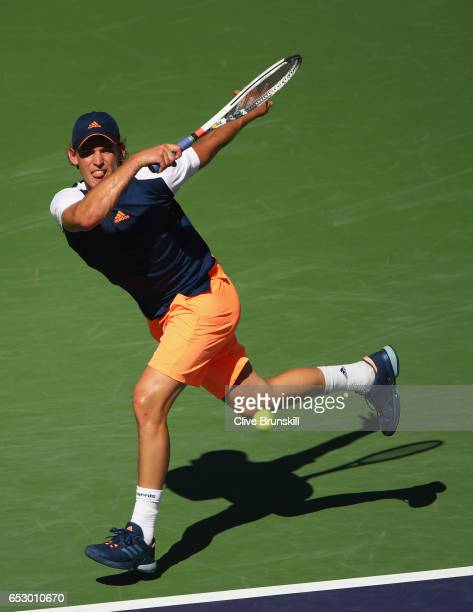 Dominic Thiem of Austria plays a forehand against Mischa Zverev of Germany in their third round match during day eight of the BNP Paribas Open at...