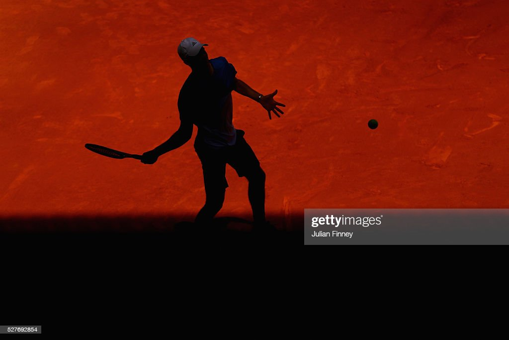 <a gi-track='captionPersonalityLinkClicked' href=/galleries/search?phrase=Dominic+Thiem&family=editorial&specificpeople=7026383 ng-click='$event.stopPropagation()'>Dominic Thiem</a> of Austria plays a forehand in his match against Juan Martin Del Potro of Argentina during day four of the Mutua Madrid Open tennis tournament at the Caja Magica on May 03, 2016 in Madrid, Spain.