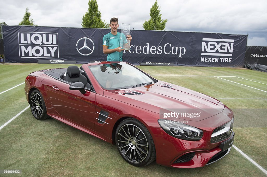 Dominic Thiem of Austria poses with the trophy after the final match againts Philipp Kohlschreiber of Germany on day 10 of Mercedes Cup 2016 on June 13, 2016 in Stuttgart, Germany.