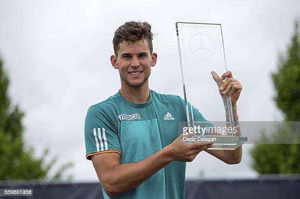 Dominic Thiem of Austria poses with the trophy after the final match againts Philipp Kohlschreiber of Germany on day 10 of Mercedes Cup 2016 on June...