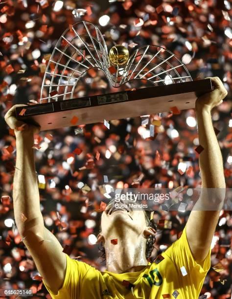 Dominic Thiem of Austria raises his trophy after defeating Pablo Carreno Busta of Spain during the Final of the ATP Rio Open 2017 at Jockey Club...