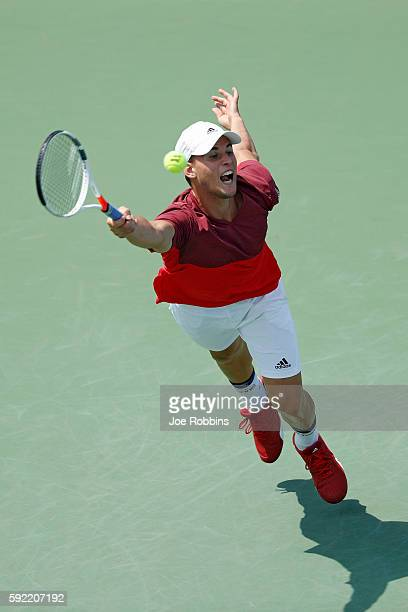 Dominic Thiem of Austria reaches but is unable to get to a serve from Milos Raonic of Canada during a quarterfinal match on Day 7 of the Western...