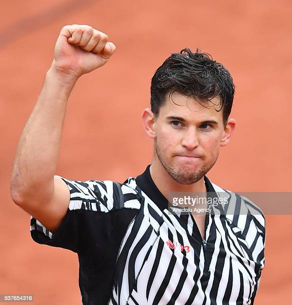 Dominic Thiem of Austria reacts after winning the men's single quarter final match against David Goffin of Belgium at the French Open tennis...