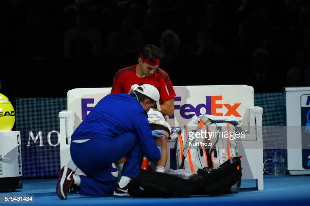 Dominic Thiem of Austria receives treatment in his Singles match against David Goffin of Belgium during day six of the Nitto ATP World Tour Finals at...