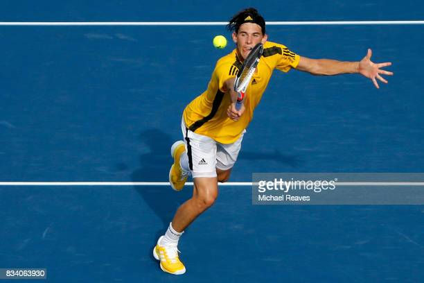 Dominic Thiem of Austria returns a shot to Adrian Mannarino of France during Day 6 of the Western and Southern Open at the Lindner Family Tennis...