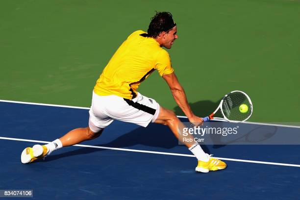 Dominic Thiem of Austria returns a shot to Adrian Mannarino of France during Day 6 of the Western and Southern Open at the Linder Family Tennis...