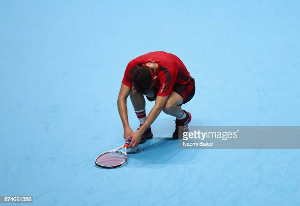 Dominic Thiem of Austria returns the ball during the singles match against Pablo Carreno Busta of Spain on day four of the 2017 Nitto ATP World Tour...
