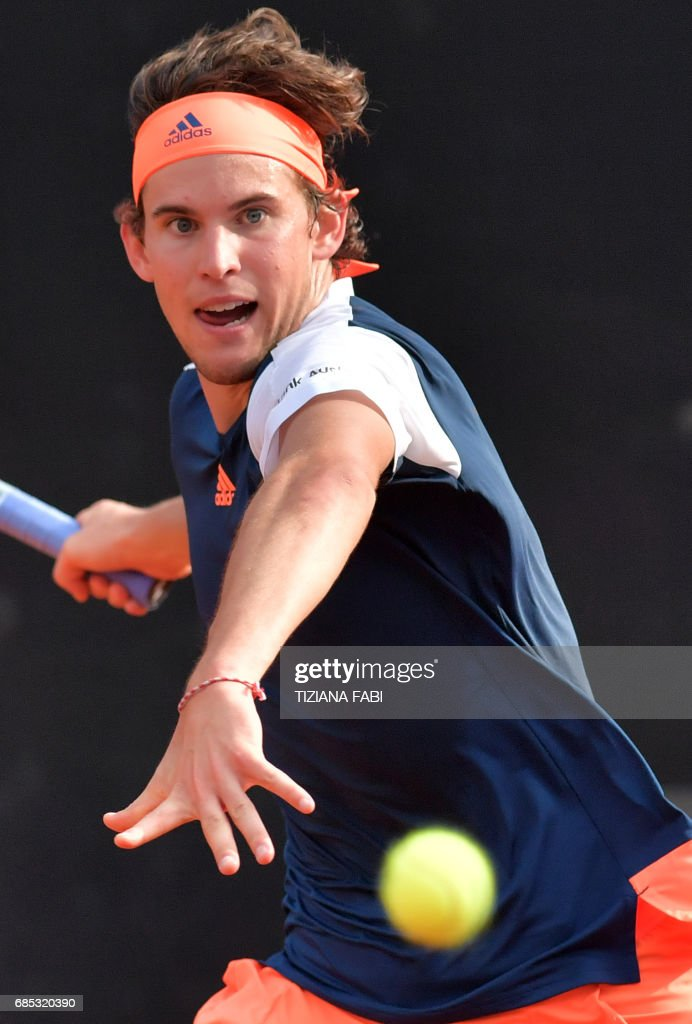 Dominic Thiem of Austria returns the ball to Rafael Nadal of Spain during their quarter-final at the ATP Tennis Open tournament on May 19, 2017 at the Foro Italico in Rome. Austria's Dominic Thiem sent Rafael Nadal crashing out of the Rome Masters with a 6-4, 6-3 quarter-final victory, ending the Spaniard's 17-match winning run. /