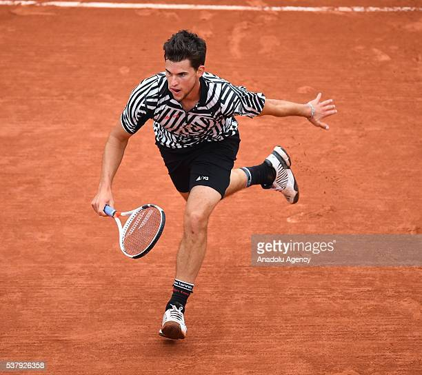 Dominic Thiem of Austria returns to Novak Djokovic of Serbia during the men's single semi final match at the French Open tennis tournament at Roland...