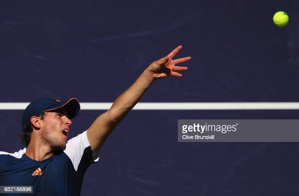 Dominic Thiem of Austria serves against Jeremy Chardy of France in their second round match during day six of the BNP Paribas Open at Indian Wells...