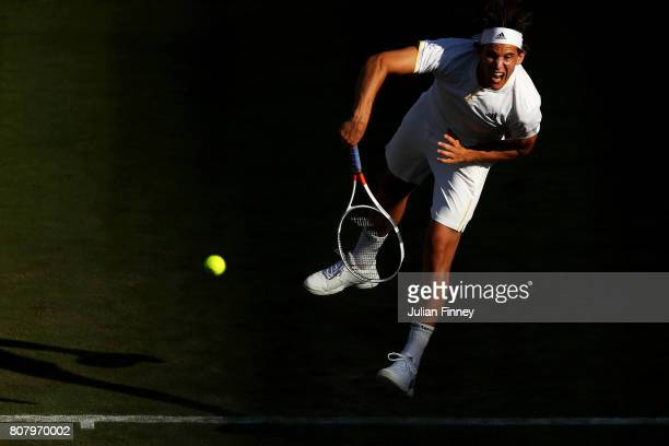Dominic Thiem of Austria serves during the Gentlemen's Singles first round match against Vasek Pospisil of Canada on day two of the Wimbledon Lawn...