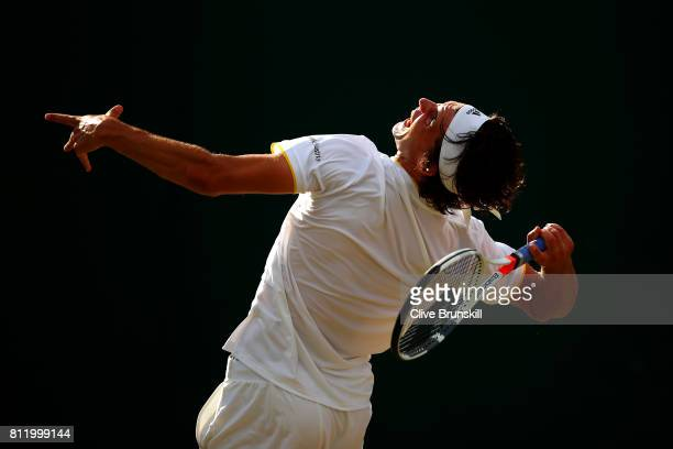 Dominic Thiem of Austria serves during the Gentlemen's Singles fourth round match against Tomas Berdych of The Czech Republic on day seven of the...