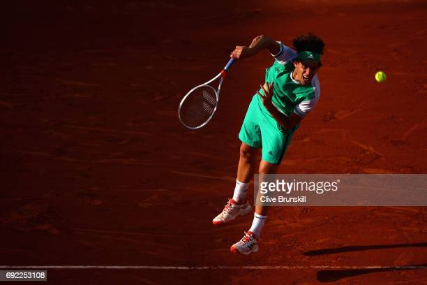 Dominic Thiem of Austria serves during the mens singles fourth round match against Horacio Zeballos of Argentina on day eight of the 2017 French Open...