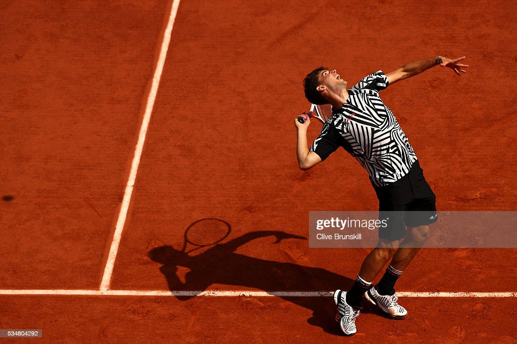 <a gi-track='captionPersonalityLinkClicked' href=/galleries/search?phrase=Dominic+Thiem&family=editorial&specificpeople=7026383 ng-click='$event.stopPropagation()'>Dominic Thiem</a> of Austria serves during the Men's Singles third round match against Alexander Zverev of Germany on day seven of the 2016 French Open at Roland Garros on May 28, 2016 in Paris, France.