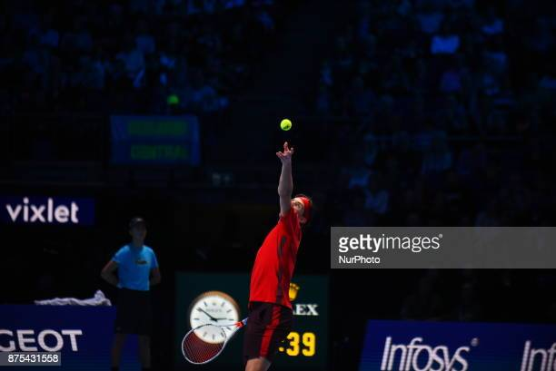 Dominic Thiem of Austria serves in his Singles match against David Goffin of Belgium during day six of the Nitto ATP World Tour Finals at O2 Arena on...