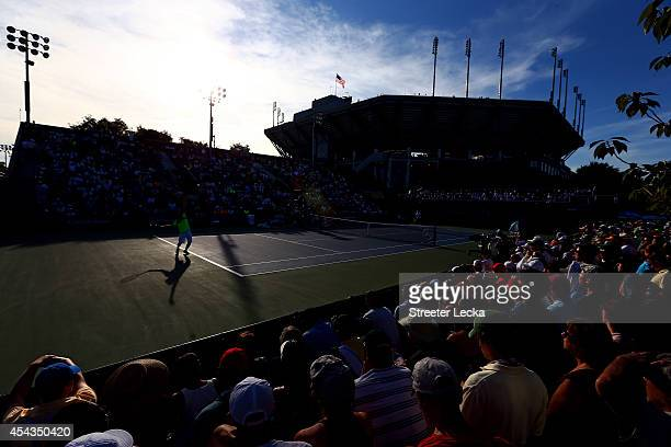 Dominic Thiem of Austria serves to Ernests Gulbis of Latvia during their men's singles second round match on Day Five of the 2014 US Open at the USTA...