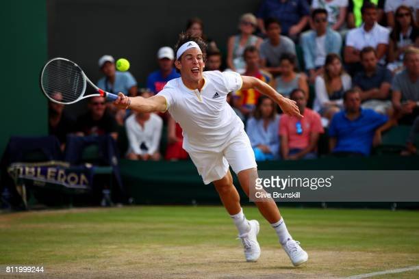 Dominic Thiem of Austria stretches to play a forehand during the Gentlemen's Singles fourth round match against Tomas Berdych of The Czech Republic...