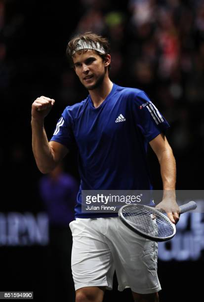 Dominic Thiem of Team Europe celebrates after winning match point his singles match against John Isner of Team World on the first day of the Laver...