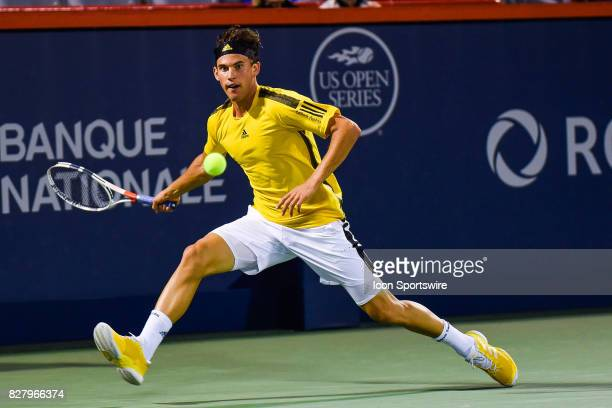 Dominic Thiem stretches out and makes eye contact with the ball then returns the ball during his first round match at ATP Coupe Rogers on August 8 at...