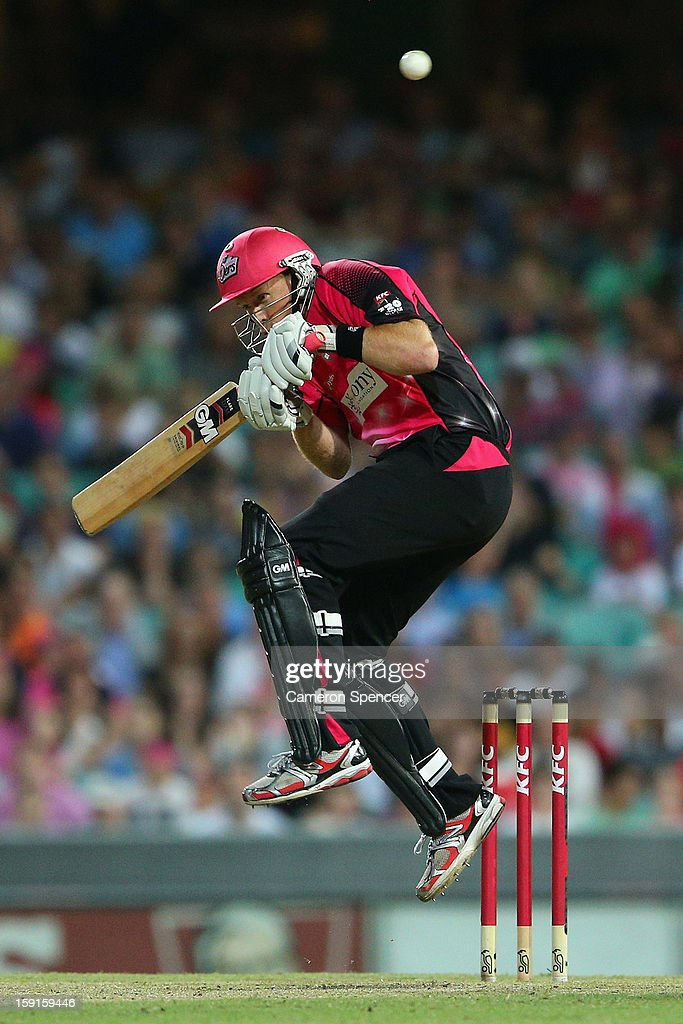 Dominic Thornely of the Sixers ducks under a bouncer during the Big Bash League match between the Sydney Sixers and the Melbourne Renegades at SCG on January 9, 2013 in Sydney, Australia.