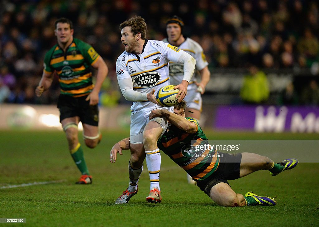 Dominic Waldouck of Northampton Saints tackles Elliot Daly of Wasps during the Aviva Premiership match between Northampton Saints and Wasps at Franklin's Gardens on March 27, 2015 in Northampton, England.