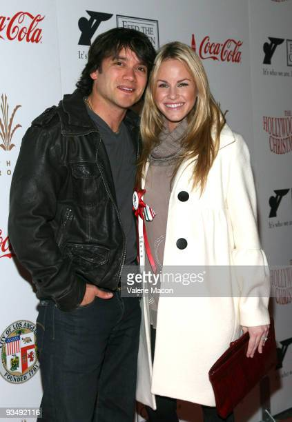 Dominic Zamprogna and Julie Berman attend the 2009 Hollywood Christmas Parade on November 29 2009 in Hollywood California
